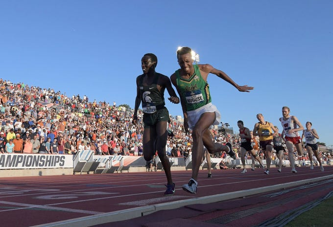 Jun 7, 2019; Austin, TX, USA; Yared Nuguse of Notre Dame (right) defeats Justine Kiprotich of Michigan State to win the 1,500m, 3:41.381 to 3:41.384, during the NCAA Track & Field Championships at Mike A. Myers Stadium. Mandatory Credit: Kirby Lee-USA TODAY Sports