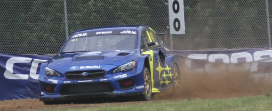 Subaru's Scott Speed drifts through the dirt at Mid-Ohio Sports Car Course on his way to the first ever America's Rallycross at Mid-Ohio championship.