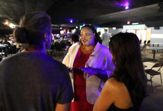 Mayoral candidate Tami Sawyer chats with people during Up the Vote's Memphis People's Convention at the Paradise Entertainment Center Saturday, June 8, 2019.