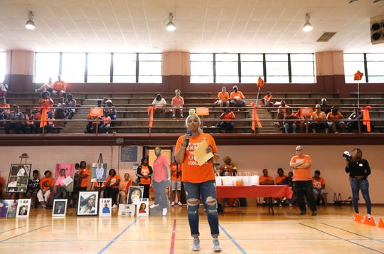 Marsha Wilson speaks to the crowd gathered at the Orange Mound Community Center as the Memphis chapter of Moms Demand Action holds a rally on National Gun Violence Awareness Day on Saturday.