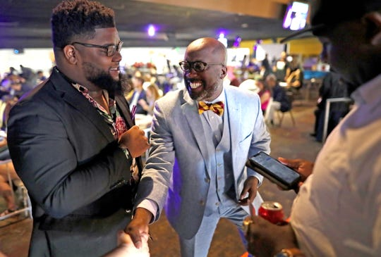 Mayoral candidate Lemichael Wilson chats with people during UpTheVote901's Memphis People's Convention at the Paradise Entertainment Center Saturday, June 8, 2019.