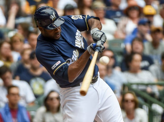 The Brewers' Lorenzo Cain hits a single to drive in a run in the second inning.
