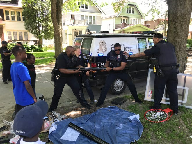 Officers needed all their strength to put together the brand new hoop.