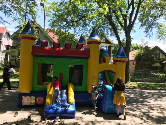 Children play on a bouncy castle as part of the block party thrown by District 3 police officers.