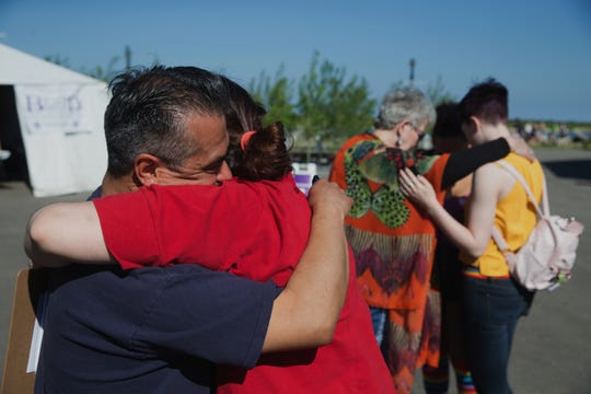 blessed_pridefest, nws, hs, 8 of 10 - Minister Denise Cawley and Leonel Marchan embrace after she gives him a blessing at Pridefest in in Milwaukee, Wisconsin, on on Friday, June 7, 2019. The two have known each other for many years and were part of the founding of the LGBTQ center in Milwaukee over twenty years ago. Hannah Schroeder/Milwaukee Journal Sentinel