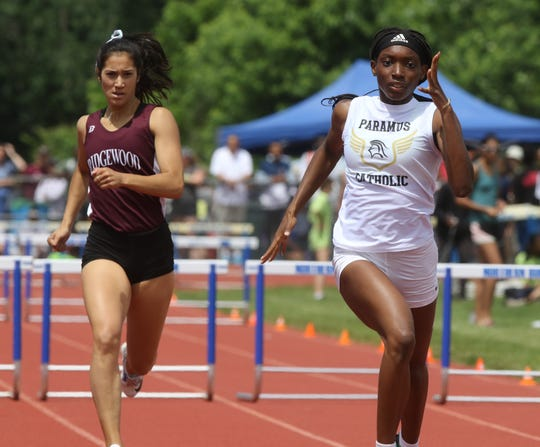 Katherine Muccio of Ridgewood and Mariah Fede of Paramus Catholic compete in the Girls 400 Meter Hurdles.