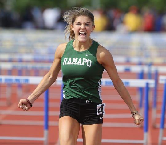 Grace O'Shea after winning the Girls 100 meter hurdles.