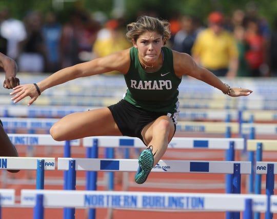 Grace O'Shea on her way to winning the Girls 100 meter hurdles.
