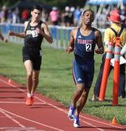 Luis Peralta of Passaic wins the Boys 800 meter run.