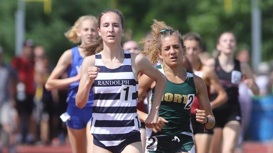 Chloe Gonzalez of North Hunterdon eventually passes Abby Loveys of Randolph to win the Girls 1600.