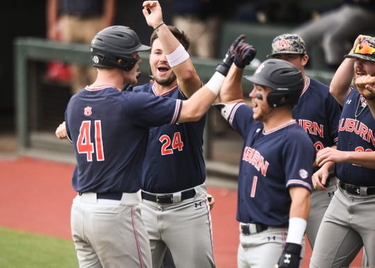 Auburn's Steven Williams (41) celebrated with teammates after hitting a home run against North Carolina on Saturday, June 8, 2019, in Chapel Hill, NC.
