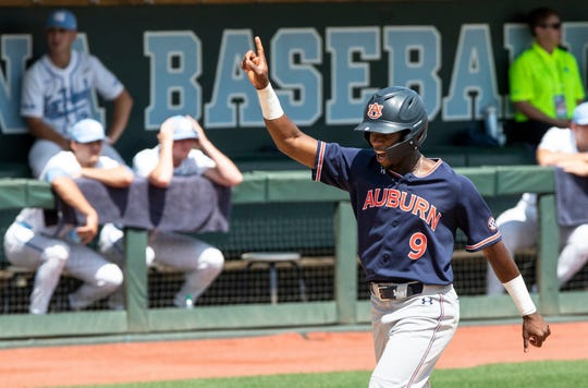 Auburn's Ryan Bliss (9) scores on a home run hit by teammate Edouard Julien during the ninth inning against North Carolina in Game 1 of a Super Regional in Chapel Hill, N.C., Saturday, Jun 8, 2019.