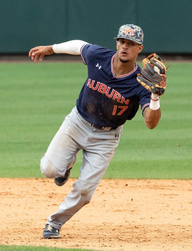 Auburn's Will Holland (17) fields a ground ball against North Carolina during Game 1 at the NCAA college baseball super regional tournament in Chapel Hill, N.C., Saturday, Jun 8, 2019. (AP Photo/Ben McKeown)