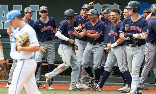 Auburn players celebrates after taking the lead over North Carolina during Game 1 at the NCAA college baseball super regional tournament in Chapel Hill, N.C., Saturday, Jun 8, 2019. (AP Photo/Ben McKeown)