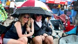 Fans dry off after the rain clears quickly to start The Great Tennessee Air Show