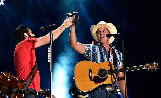 Thomas Rhett and Jon Pardi toast during the 2019 CMA Fest Friday, June 7, 2019, at Nissan Stadium in Nashville, Tenn.