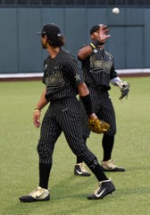 Vanderbilt third baseman Austin Martin (16) flips the ball to second baseman Harrison Ray (2) as they warm up before a game against Duke in the Super Regional at Hawkins Field.