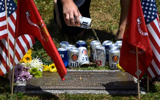 """We all crack a beer and pour a little on the grave and say 'Wish you were here.' It's really powerful,"" said Derrick Kepler. About 50 Marines who were assigned to Golf Company, 2nd Battalion, 4th Marine division and served in Iraq together in 2004 came to Nashville to remember their comrade Richard O. Quill III over the Memorial Day weekend."