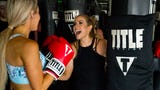 Lindsay Ell helped lead a kickboxing class for fans with her trainer Jarrod Houston at Title Nash during CMA Fest. Ell teamed with Spotify for the free Spotify Hot Country Workout with Lindsay Ell at Title Boxing Club.