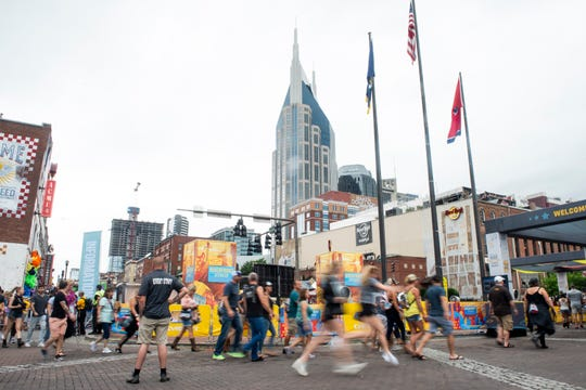 Festival goers rush to the Chevy Riverfront Stage during the 2019 CMA Fest at Lower Broadway in Nashville, Tenn., Friday, June 7, 2019. As concerns about the coronavirus grow and events in Nashville are canceled, there may be smaller crowds on Lower Broadway as fewer tourists visit the Music City.