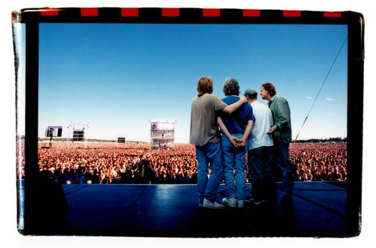 The members of Phish sing acapella for the massive crowd at 1997's 'The Great Went.' Phish held several large outdoor concerts in the 1990s, which created a blueprint for the creation of Bonnaroo.