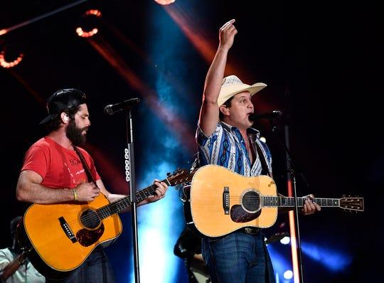 Thomas Rhett, left, performs with Jon Pardi during the 2019 CMA Music Festival at Nissan Stadium.