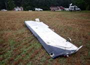 A wing from a Piper PA-46 airplane rests in a field on Friday, June 7, 2019, in the 2000 block of Harrison Road in the Aventon community in Nash County near Rocky Mount, N.C.