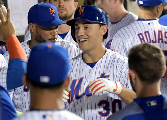 New York Mets' Michael Conforto (30) celebrates with teammates after hitting a home run during the sixth inning of a game against the Colorado Rockies on Friday, June 7, 2019, in New York.