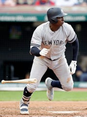 New York Yankees' Didi Gregorius heads to first on a single during the fourth inning of the team's baseball game against the Cleveland Indians, Friday, June 7, 2019, in Cleveland.