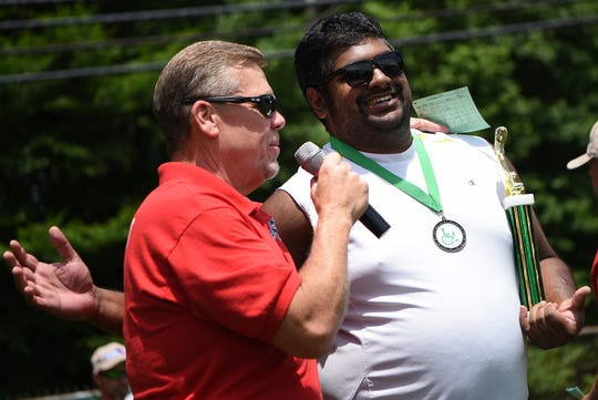 The Norm Trass Memorial Outing for the Disabled held in Mahwah on Saturday June 8, 2019. Brian Mahoney, Co-Director of the event, hands a trophy to Ryan Roy.