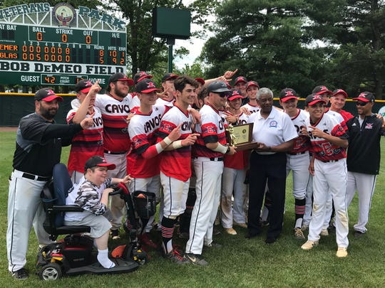 The Emerson baseball team collects its trophy after rallying to an 8-5 win over Glassboro in the NJSIAA Group 1 baseball final at Hamilton Veterans Park on Saturday, June 8, 2019.