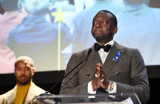 Honoree Yusef Salaam, right, becomes emotional as he addresses the audience at the ACLU SoCal's 25th Annual Luncheon at the JW Marriott at LA Live, Friday, June 7, 2019, in Los Angeles. Looking on at left is presenter Michael B. Jordan. (Photo by Chris Pizzello/Invision/AP)