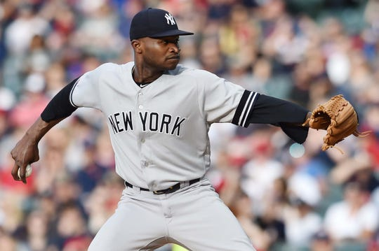 Jun 7, 2019; Cleveland, OH, USA; New York Yankees starting pitcher Domingo German (55) throws a pitch during the first inning against the Cleveland Indians at Progressive Field.