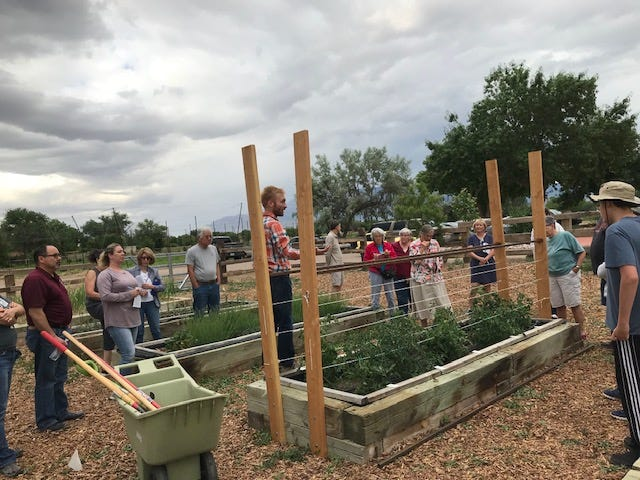 "Bernalillo County Cooperative Extension Agriculture Agent John Garlisch leads a ""Summer Raised Bed Gardening"" workshop in Albuquerque, the first week of June 2019."