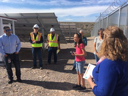 Eleanor Warden (in pink shirt), a fifth-grade student at Sonoma Elementary, listens as City of Las Cruces Sustainability Officer Lisa LaRocque (in blue), describes the array of solar panels used to power the East Mesa Water Reclamation Facility.