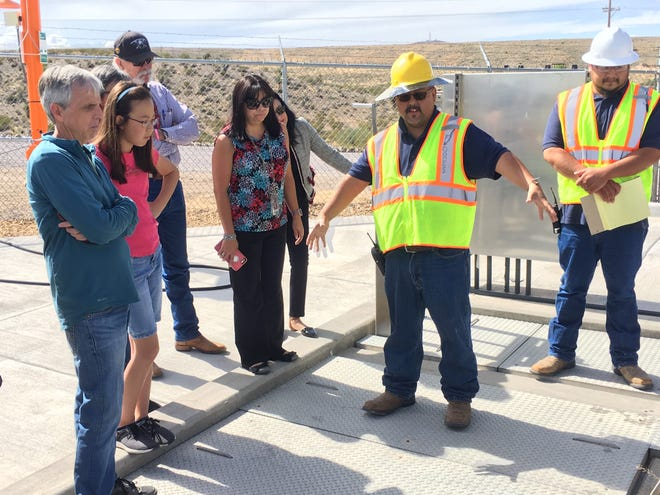 A staff member at the East Mesa Water Reclamation Plant describes how wastewater is treated with ultraviolet light in one of the facility's final treatment steps, as Eleanor Warden (in pink shirt), a fifth-grade student at Sonoma Elementary, listens.