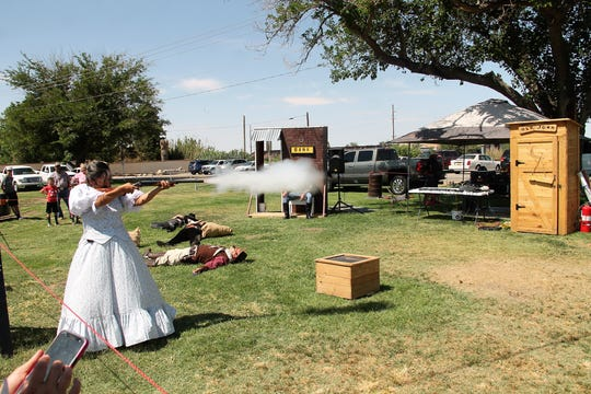 A member of the New Mexico Gunslingers fires a shotgun during a wild west show at he first annual Alamogordo Founders Day Celebration put on by the Tularosa Basin Historical Society took place at Alameda Park Saturday, June 8.