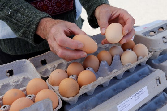 Karl and Tipi's Farm, based in La Plata, showcases its ungraded eggs during the opening day of the annual Grower's Market Saturday in Farmington. Ungraded eggs, which must be labeled as such by law, are unwashed to keep bacteria from penetrating the shell.