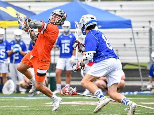 Brother Rice's Justin Glod goes in for a shot in front of Catholic Central's Keegan Koehler.