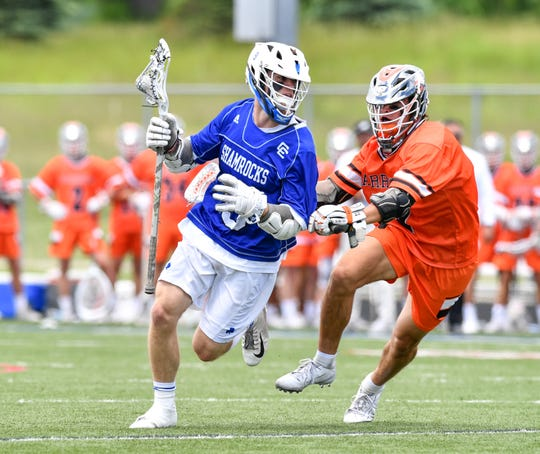 Catholic Central's Ryan Birney looks up the field against Brother Rice.