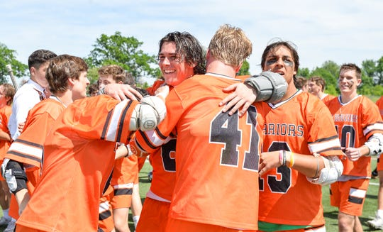 Brother Rice players celebrate after winning the state championship.