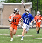 Brother Rice's Mike Cosgrove runs by Catholic Central's Justin Petouhoff in the state title game.