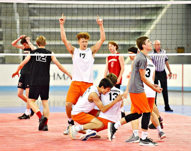 The York Suburban boys' volleyball team celebrates during the PIAA Class 2-A state title match against Meadville on June 8. The Trojans lost that match, 3-2. Suburban had six players named to the All-District 3 Class 2-A Team by the Pennsylvania Volleyball Coaches Association. Dawn J. Sagert photo