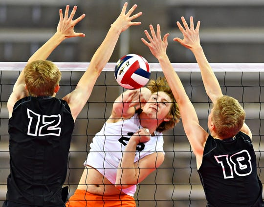 York Suburban's John Doll, center, hits the ball while Meadville's Charlie Waid, left, and Paul Leech defend during PIAA Class 2-A boys' volleyball championship action at Pegula Ice Arena in State College, Saturday, June 8, 2019. Dawn J. Sagert photo