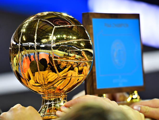 A PIAA championship trophy is on display. A proposed act would separate public and private schools for Pennsylvania high school playoffs.