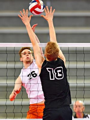 York Suburban's Declan Ridings, left, hits the ball while Meadville's Paul Leech defends during PIAA Class 2-A boys' volleyball championship action at Pegula Ice Arena in State College, Saturday, June 8, 2019. Dawn J. Sagert photo