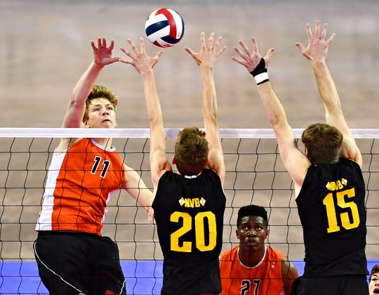 Central York's Braden Richard, left, hits the ball while North Allegheny's Grant Jones, center, and Alex Zubrow defend during PIAA Class 2-A boys' volleyball championship action at Pegula Ice Arena in State College, Saturday, June 8, 2019. Dawn J. Sagert photo