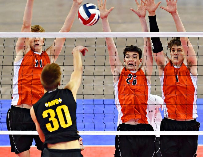 Central York's Braden Richard, Eric Bowman and Alex Gekus defend against North Allegheny during PIAA Class 2-A boys' volleyball championship action at Pegula Ice Arena in State College, Saturday, June 8, 2019. Dawn J. Sagert photo