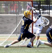 Victor goalie Liam Haller makes a big save in the fourth quarter against John Jay.
