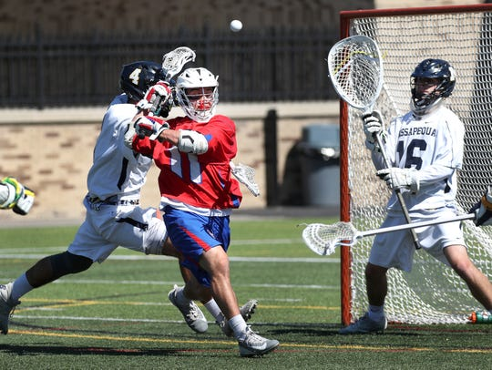 Fairport's Alex Nicastro shoots behind his head on Massapequa goalie Nicholas Squicciarini in the Class A title game.